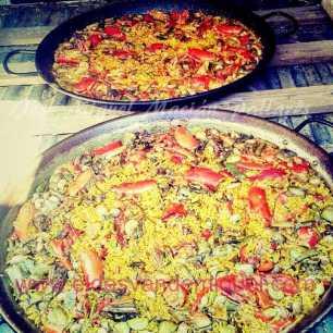 Paella de bogavante, pato y caracoles blancos (de secano)